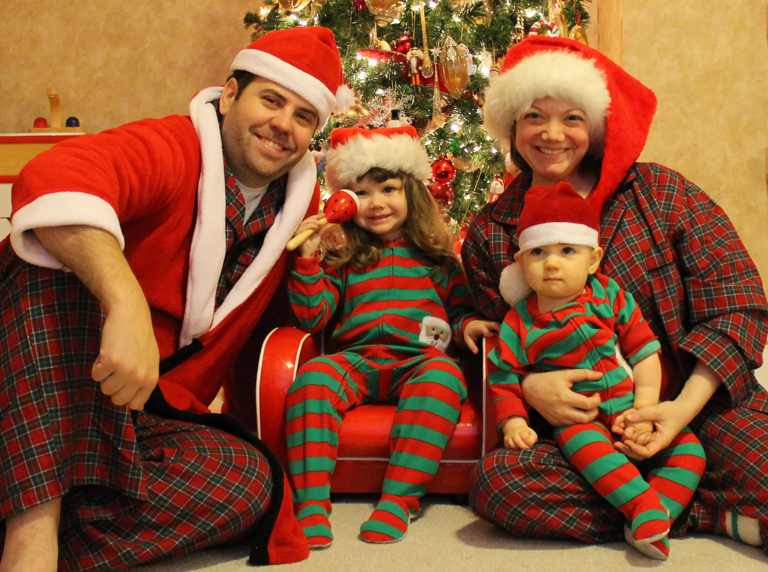 "Meh-rry Christmas ""My sister and I thought it might be a good idea to have our kids' photos taken as a Christmas present for my mom. With two hungry, tired newborn babies and a bored 3 year old, it was quite possibly the worst day of our lives. This was the best pic we could get of all three of them."" (submitted by Colleen)."